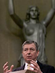 Then-AG John Ashcroft with Lady Justice - unknown photo source