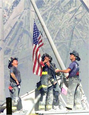 wtc-firefighters-raising-flag.jpg