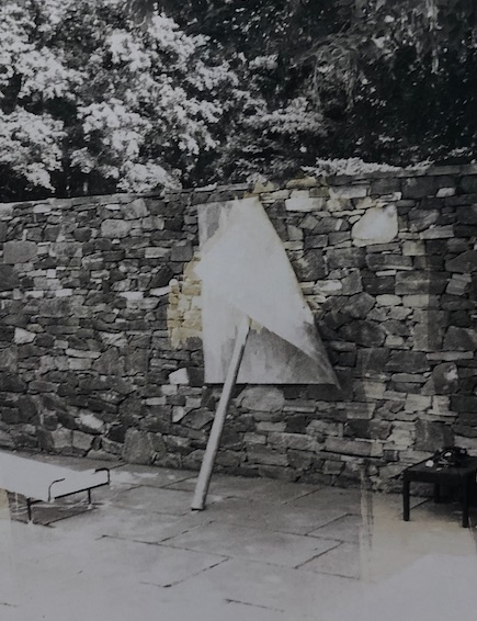 a 1969 snapshot from the pool deck of the Tremaines, where their new Richard Serra sculpture will not stop flopping over